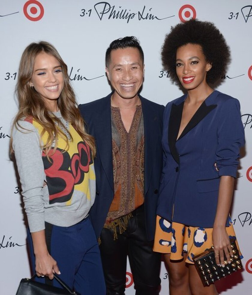 Jessica Alba, designer Phillip Lim and Solange Knowles attend the 3.1 Phillip Lim for Target launch party on Sept. 5. The collection debuts in stores Sunday.