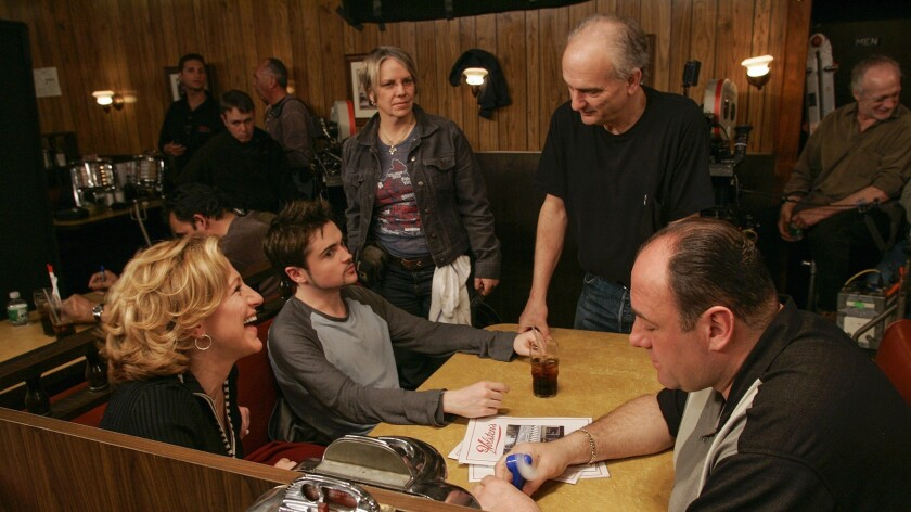 """David Chase films a scene from the series finale of """"The Sopranos"""" in 2007."""
