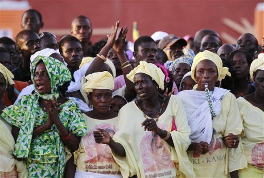 Female supporters of President Abdoulaye Wade, unseen, cheer at his arrival at a ceremony to welcome a group of Haitian students to Dakar, Senegal Wednesday, Oct. 13, 2010. Senegal is one of the poorest countries in the world and its GDP is only marginally higher than Haiti's, but that didn't stop