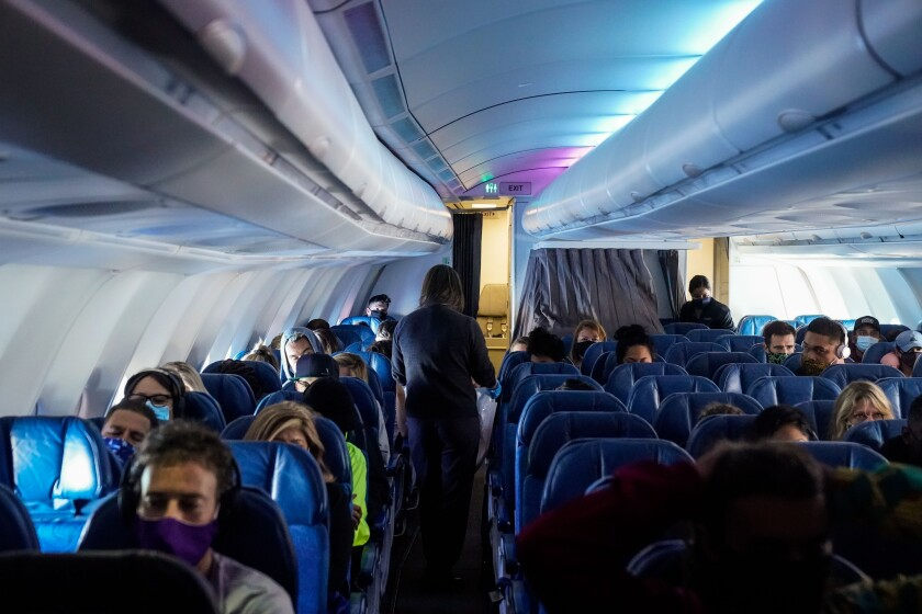 Masked passengers on a Hawaiian Airlines flight in October 2020.