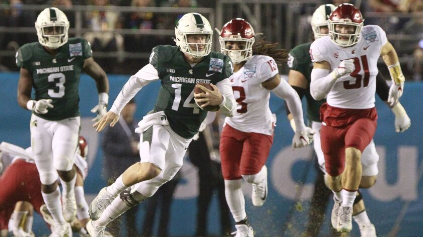 SAN DIEGO, December 28, 2017 | Michigan State's quarterback Brian Lewerke runs the ball in the first