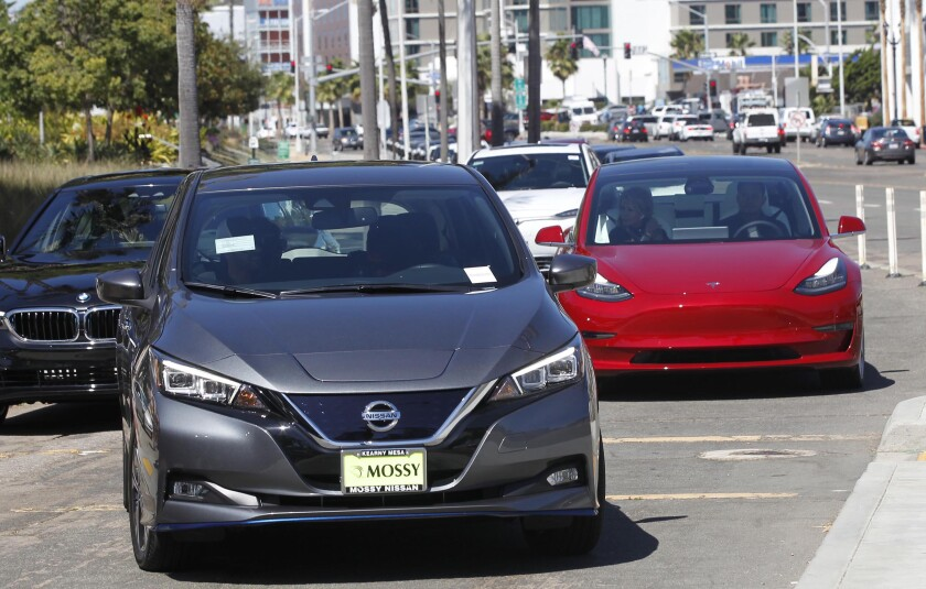 """A Nissan Leaf and a Tesla Model 3 were available for test drives in San Diego during a """"drive and ride"""" event."""