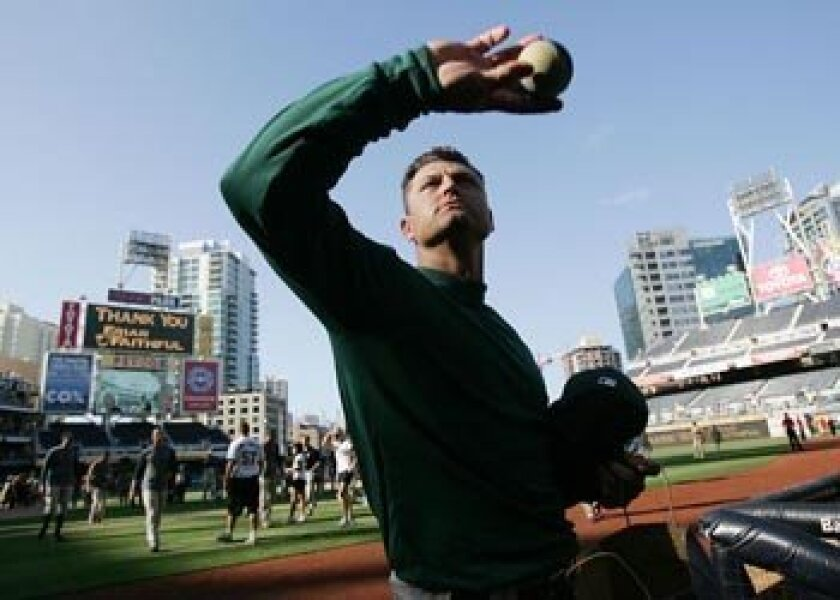 Trevor Hoffman's last throws of the season and perhaps his Padres career: tossing some toy baseballs to fans after the final game of the season, Sept. 28, 2008.