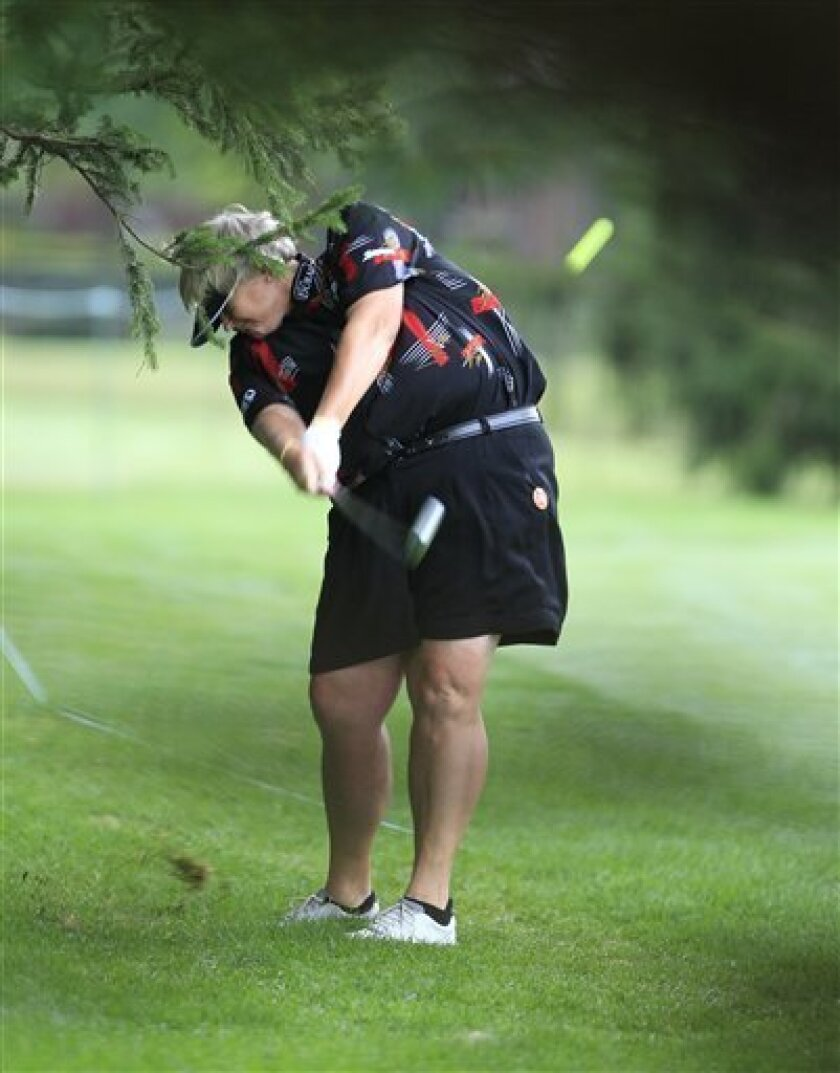 Laura Davies of England hits onto the fourth fairway during the second round of the Jamie Farr Toledo Classic at the Highland Meadows Golf Club in Sylvania, Ohio, Friday, Aug. 10, 2012. (AP Photo/Carlos Osorio)