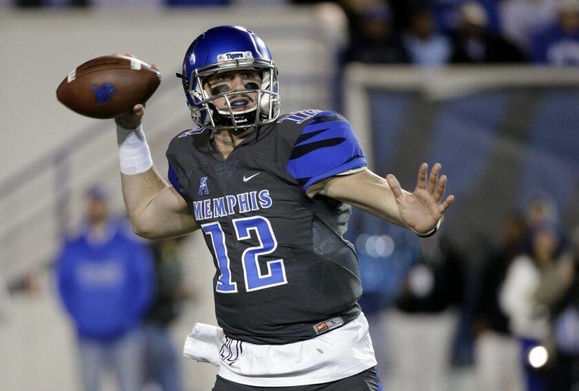 Memphis quarterback Paxton Lynch (12) passes against Navy in the first half of an NCAA college football game Saturday, Nov. 7, 2015, in Memphis, Tenn. (AP Photo/Mark Humphrey)
