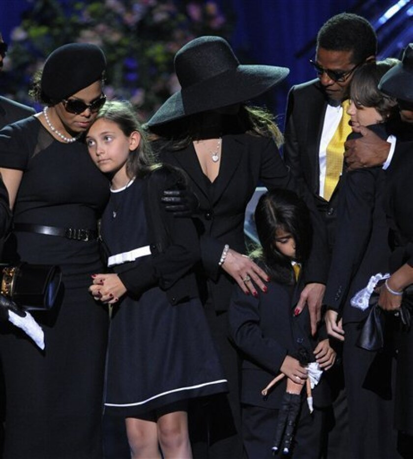 Singer Janet Jackson, left, Paris Jackson, La Toya Jackson, Jackie Jackson and Prince Michael I on stage during the memorial service for Michael Jackson at the Staples Center in Los Angeles, Tuesday, July 7, 2009. (AP Photo/Mark J. Terrill, Pool)