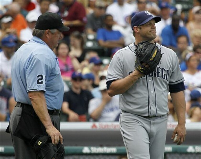 """Umpires like Joe West, who'd just called a balk on Padres left-hander Eric Stults in this photo from last season, likely won't see a lot of the old """"first-and-third"""" pickoff move by pitchers with a rule change that added it to the list of balks for 2013. (AP Photo/Charles Rex Arbogast)"""