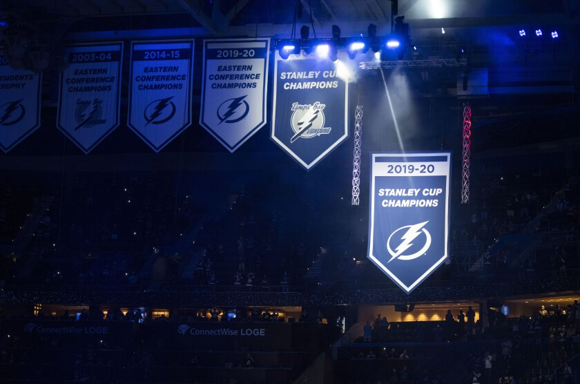 The Stanley Cup championship banner for the Tampa Bay Lightning is raised in the arena during a ceremony before the team's NHL hockey game against the Nashville Predators on Saturday, March 13, 2021, in Tampa, Fla. (AP Photo/Steve Nesius)