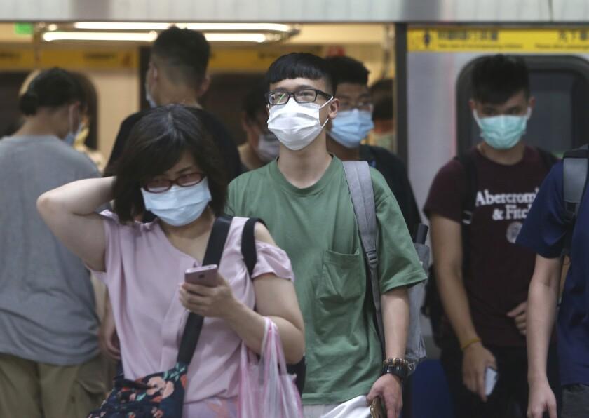 People wear masks on the subway in Taipei, Taiwan.