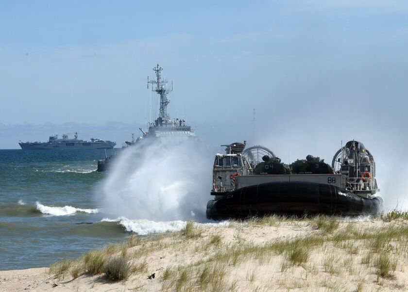 NATO troops make an amphibious landing off the coast of Ustka, northern Poland, during military exercises in mid-June. The multinational exercises aimed to demonstrate alliance capability to defend the Baltic region.