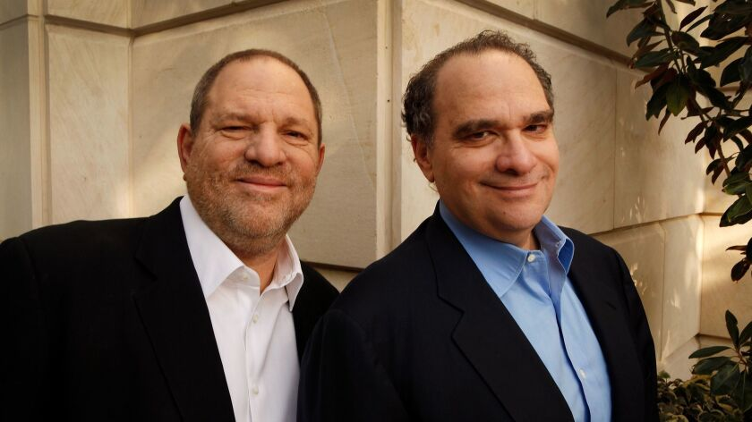 The Weinstein Co. board erupted in turmoil Friday over what to do with brothers Harvey, left, and Bob Weinstein's studio.
