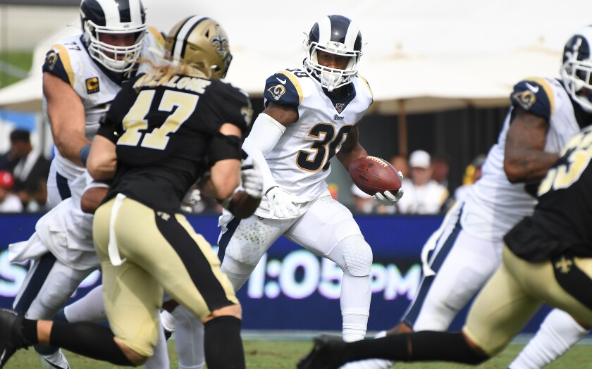 Rams runing back Todd Gurley looks for an opening while running the ball during Sunday's 27-9 victory over the Saints.