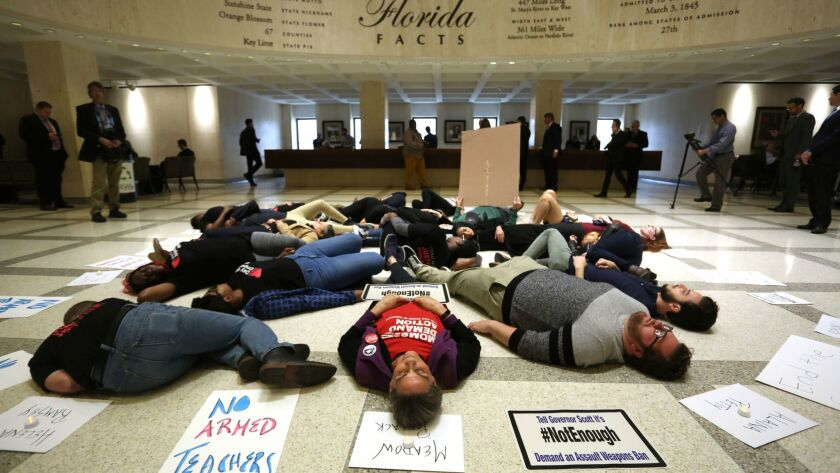 About 20 protesters participate in a die-In on the fourth floor rotunda of the Florida Capitol, in T