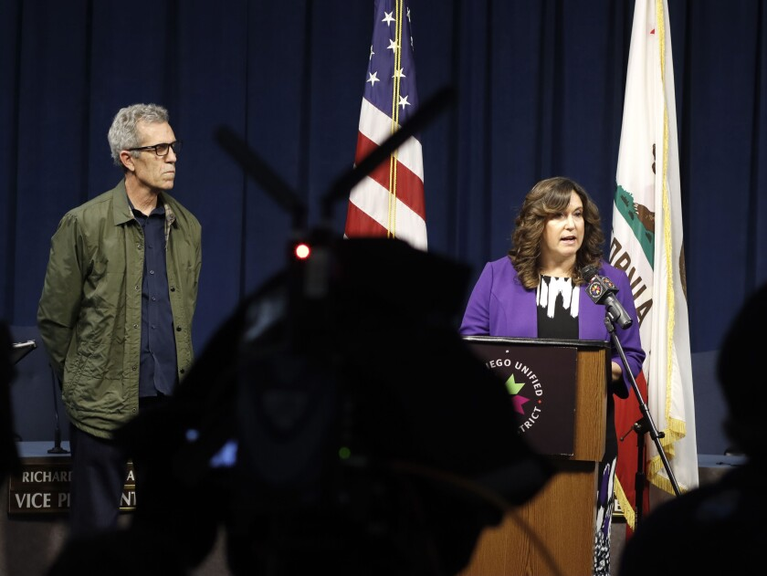 San Diego Unified School District Superintendent Cindy Marten speaks as school board president John Lee Evans, left, looks on as district officials announce they will be closing all schools starting Monday March 16 to help prevent the spread of COVID-19.