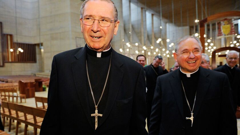 Cardinal Roger Mahony, left, walks with his successor, Archbishop Jose Gomez, at the Cathedral of Our Lady of the Angels in this 2010 file photo.