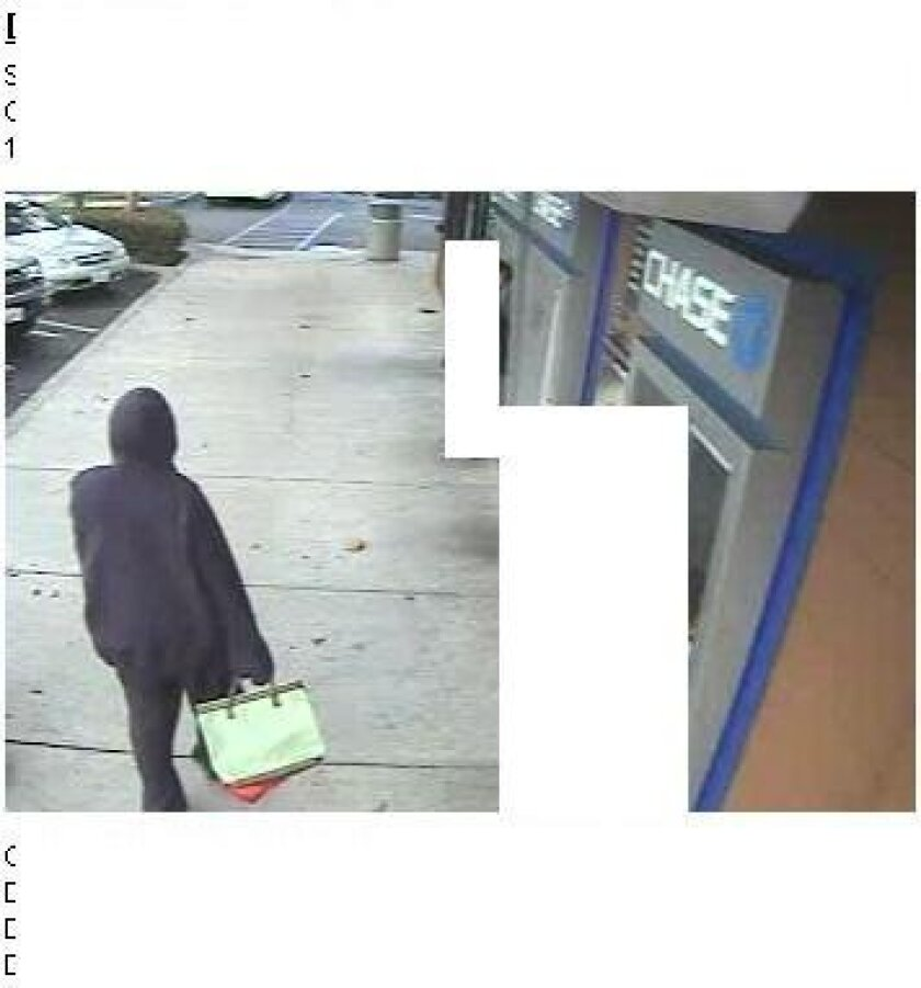 A surveillance photo from outside the National City bank. / FBI