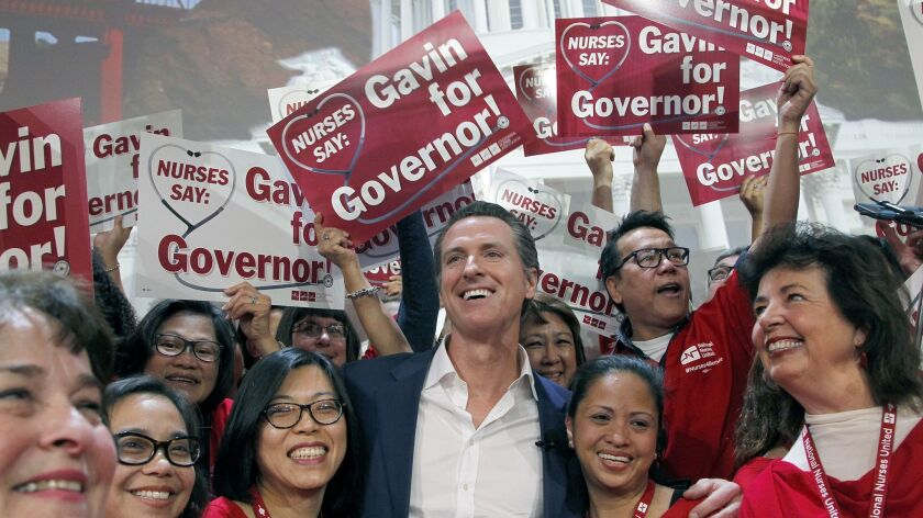 Gov.-elect Gavin Newsom at his 2015 meeting with more than 1,000 registered nurses from California and cross the nation in Los Angeles. Newsom offered his support for California Nurses Assn. proposal for a universal healthcare system, and the nurses now expect him to deliver.