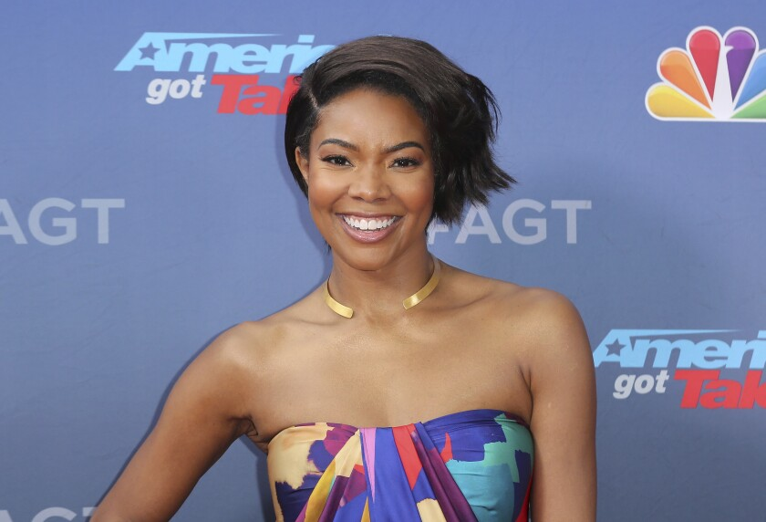 "FILE - This March 11, 2019 file photo shows Gabrielle Union at the ""America's Got Talent"" Season 14 Kickoff in Pasadena, Calif. Union has filed a complaint with the state of California over her firing from ""America's Got Talent."" The complaint filed Thursday says NBC and the show's producers subjected Union, who is black, to racism and retaliated against her when she reported it. (Photo by Willy Sanjuan/Invision/AP, File)"