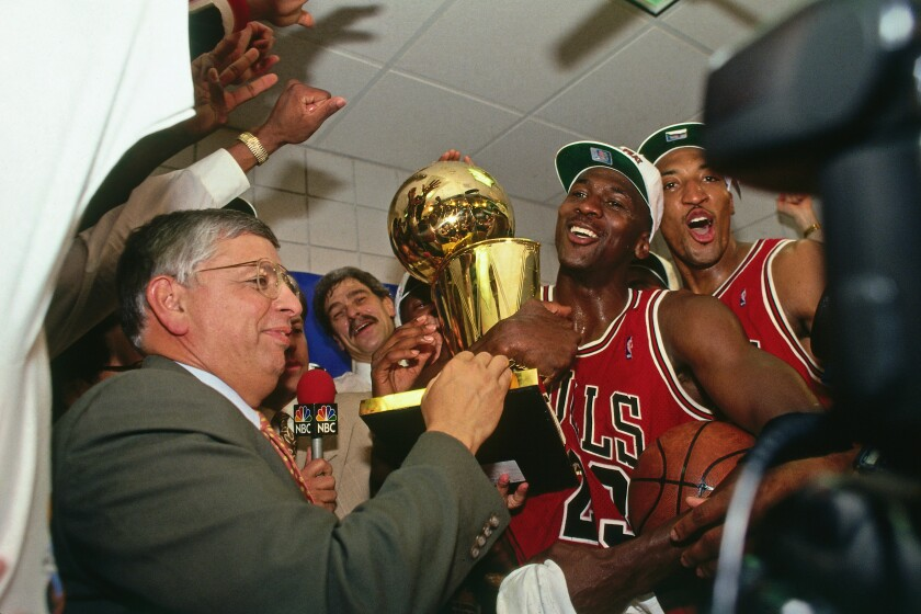 NBA Commissioner David Stern presents Michael Jordan and the Chicago Bulls the championship trophy after the Bulls defeated the Phoenix Suns in the 1993 NBA Finals.
