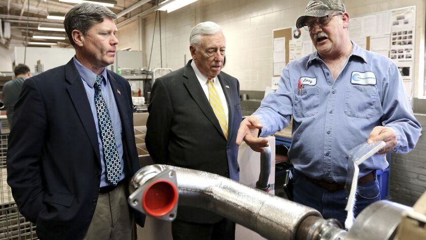 Jerry Olson, right, of Culimeta-Saveguard in Eau Claire, Wis., gives a tour to Rep. Ron Kind - D-Wis