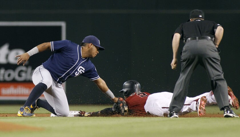 Arizona Diamondbacks second baseman Jean Segura is tagged out by San Diego Padres third baseman Yangervis Solarte, left, while trying to steal second base during the first inning on Sunday, Oct. 2, 2016.