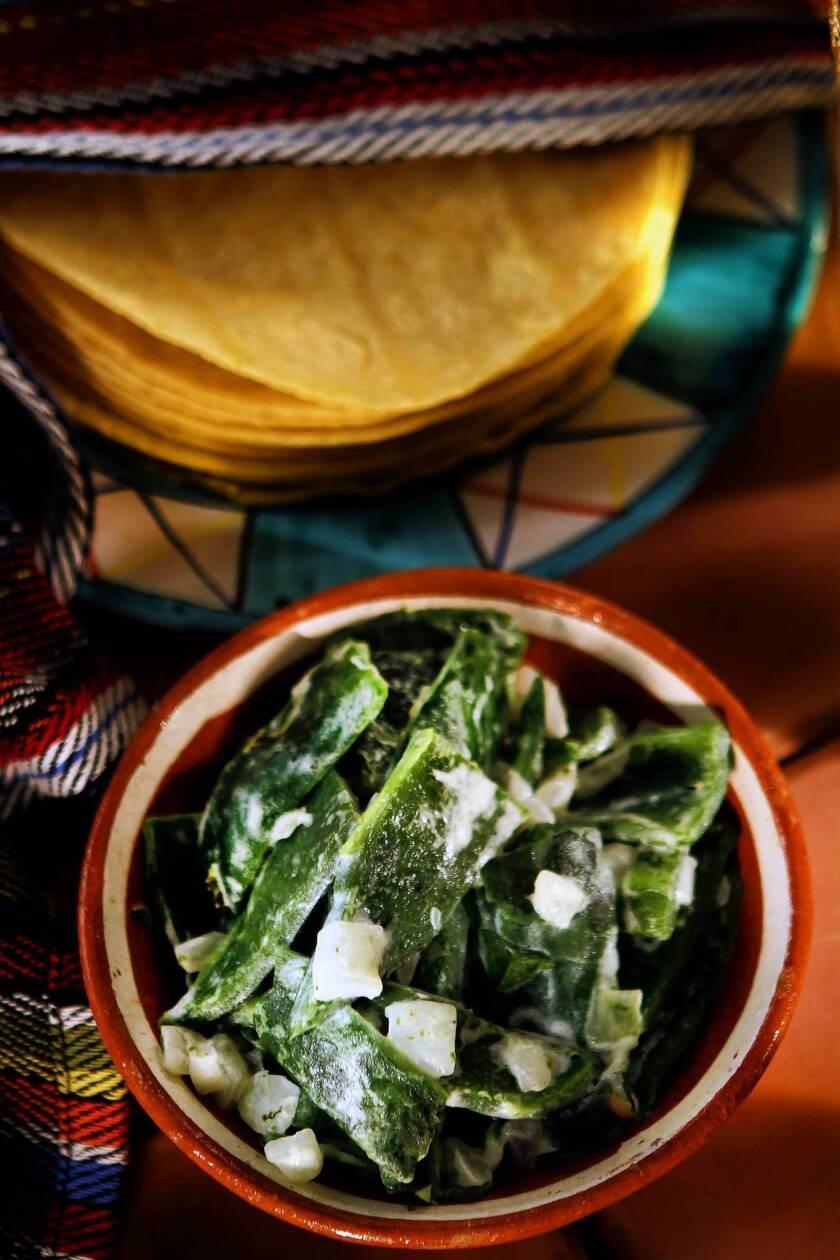 <i>Rajas con crema</i> (charred poblano pepper strips with cream)