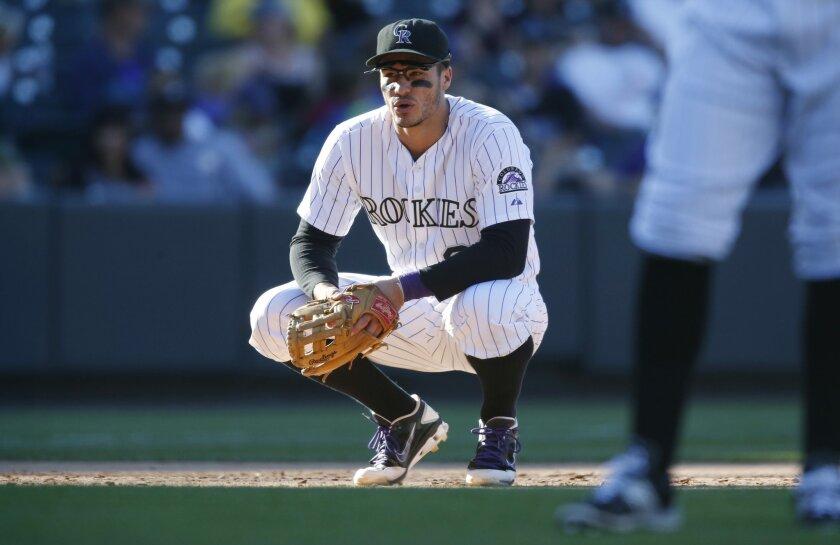 Colorado Rockies third baseman Nolan Arenado looks on in the eighth inning of a baseball game against the San Diego Padres, Sunday, Sept. 20, 2015, in Denver. San Diego won 10-4. (AP Photo/David Zalubowski)