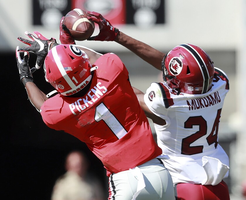 South Carolina's Israel Mukuamu intercepts a pass intended for Georgia's George Pickens on Saturday.