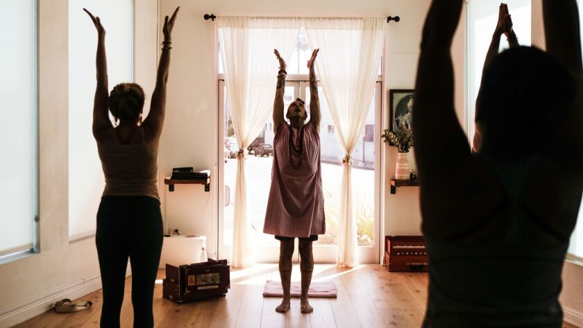 A yoga teacher leads a community class in Los Angeles.