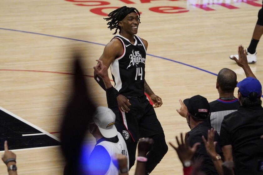 Los Angeles Clippers guard Terance Mann celebrates with fans after scoring during the second half in Game 6 of a second-round NBA basketball playoff series against the Utah Jazz Friday, June 18, 2021, in Los Angeles. (AP Photo/Mark J. Terrill)