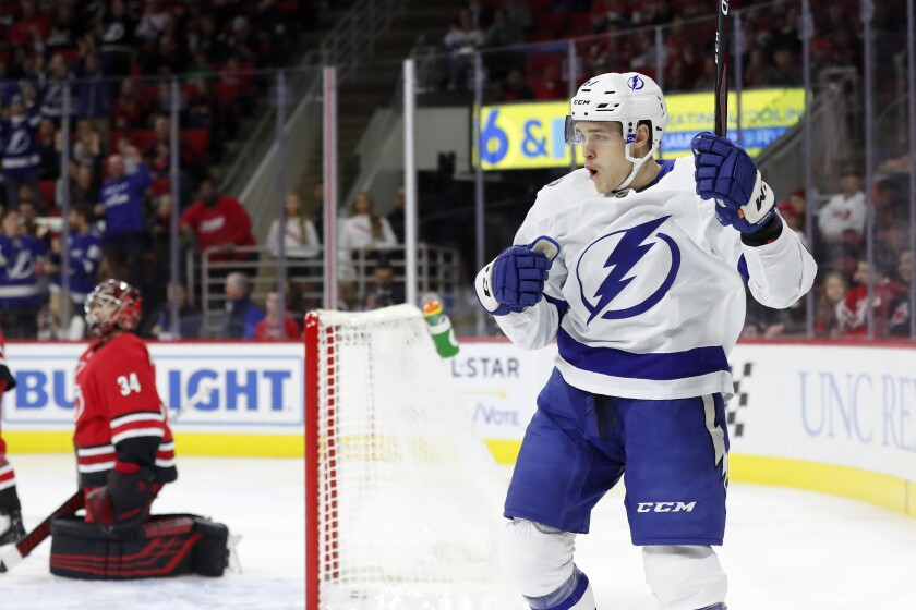 Tampa Bay Lightning center Mitchell Stephens (67) celebrates his goal agaonst Carolina Hurricanes goaltender Petr Mrazek (34), of the Czech Republic, during the first period of an NHL hockey game in Raleigh, N.C., Sunday, Jan. 5, 2020. (AP Photo/Gerry Broome)