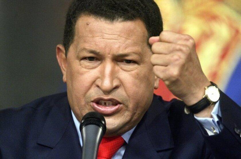 President Hugo Chavez speaks at a news conference Dec. 5, 2006, in Caracas, Venezuela.