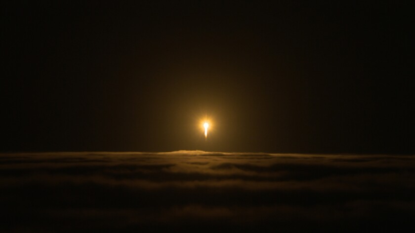A United Launch Alliance Atlas V rocket lifts off from Space Launch Complex 3 at Vandenberg Air Forc