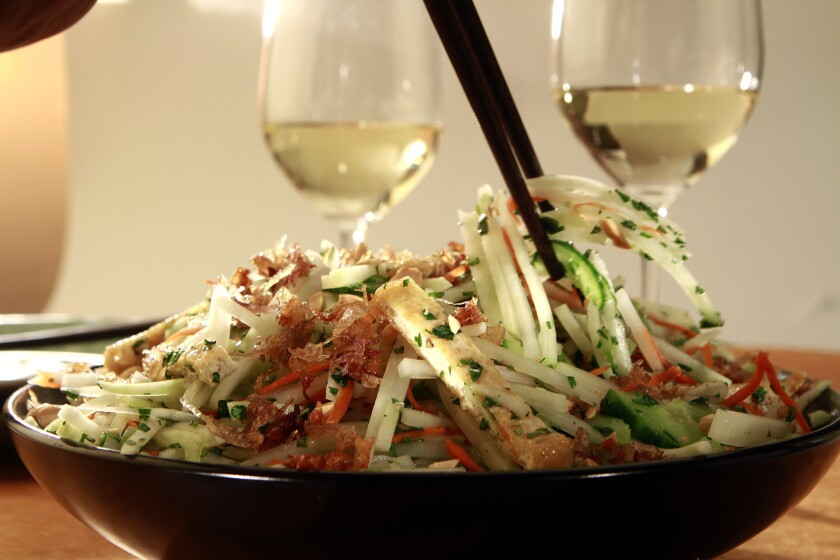 Green papaya salad pairs well with white wine, especially in summer heat.