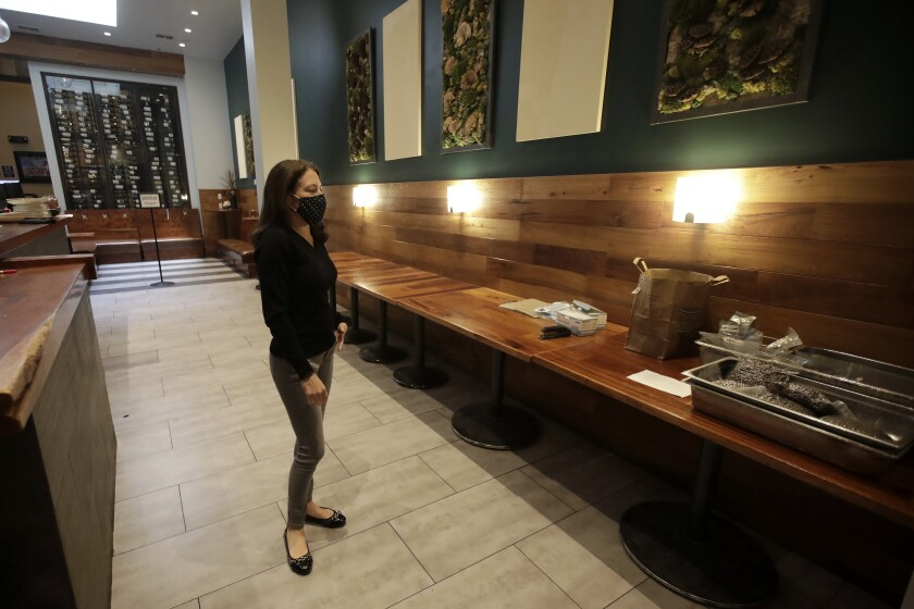 Sarah Trubnick, owner of the Barrel Room, stands inside her restaurant in July.