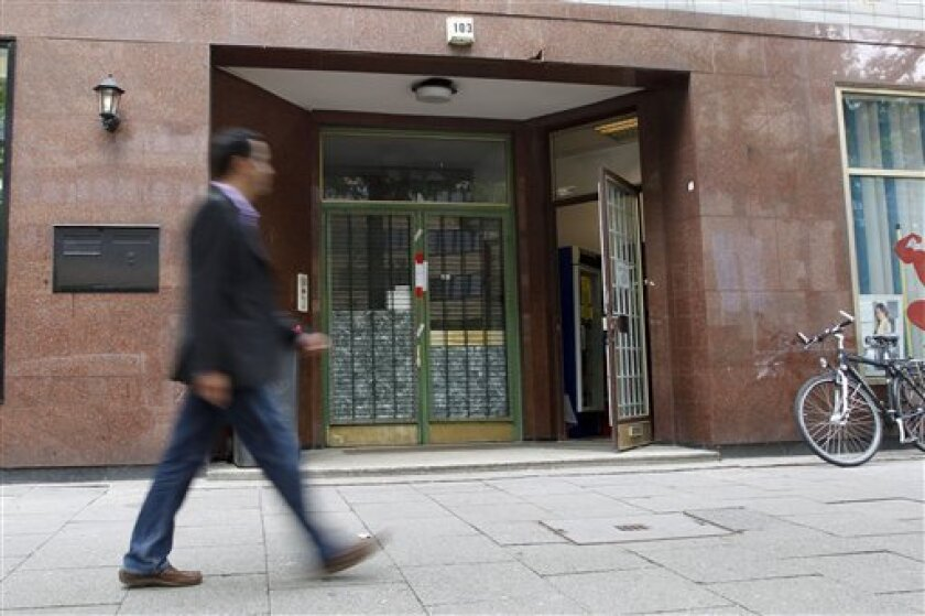 A passerby is walking in front of the police-sealed door of the former Al-Quds-mosque, now named Taiba mosque, in Hamburg, northern Germany, on Monday, Aug 9, 2010. The Hamburg mosque that was once frequented by some of the Sept. 11 attackers was closed Monday by German authorities, who said they