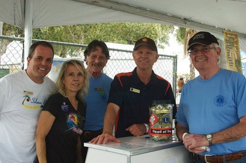 (L-R): Solana Beach Chamber of Commerce ambassador Ryan Godfrey, and Del Sol Lions members Kathleen Davis, Paul McEneany, David Cain and Chuck Dumbrell.