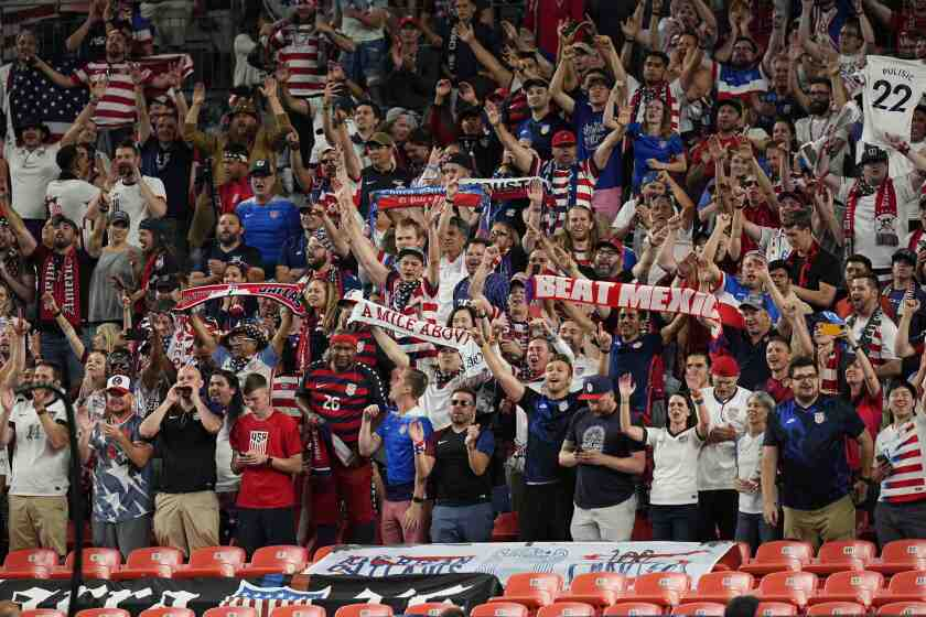 Soccer fans cheer for the United State during a CONCACAF competition in Denver.