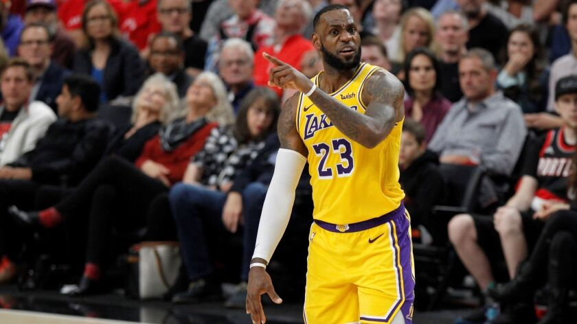 LeBron James and the Lakers lost their season opener at Portland on Thursday night.