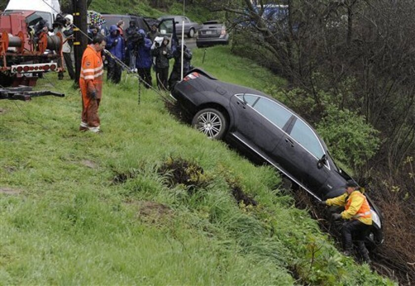 Actor Charlie Sheen's Mercedes is towed out of a ravine after it was found overturned hundreds of feet down a cliff near his home early Friday, Feb. 5, 2010, in the Sherman Oaks area of Los Angeles. (AP Photo/Gus Ruelas)