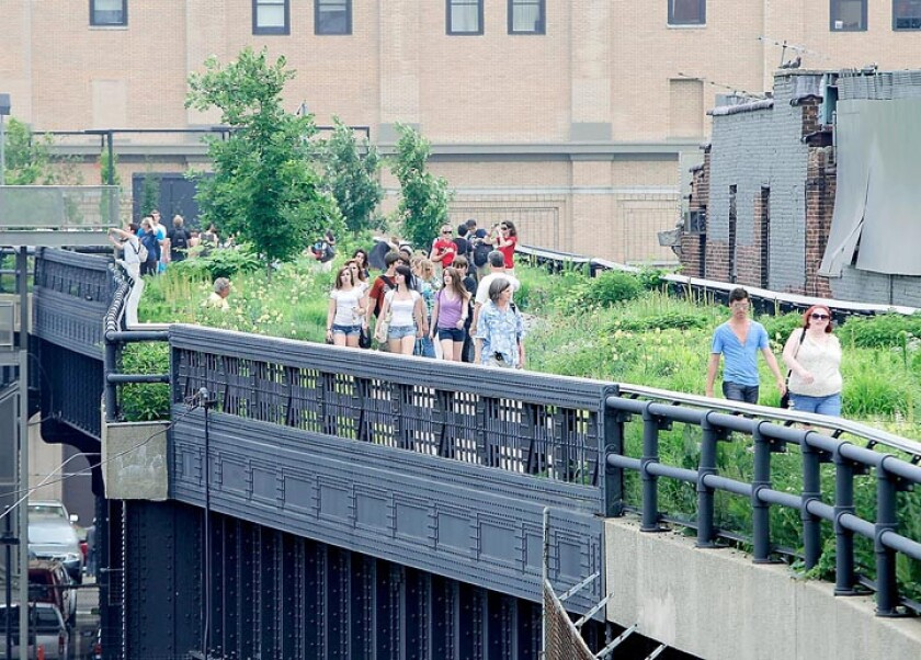 New York's High Line park, seen here in 2011, has become one of the top visitor attractions in the city. The popular park was built along an abandoned elevated train line in Manhattan.