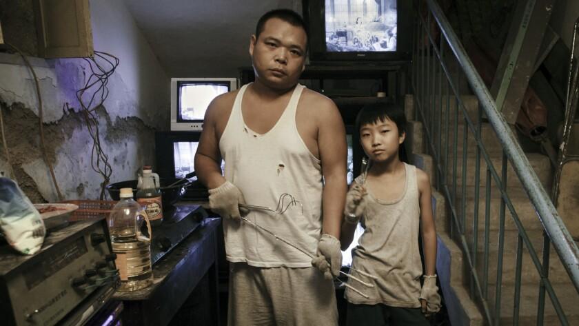"""Jun Zhao, left, and Wang Naixun in the movie """"King of Peking."""""""