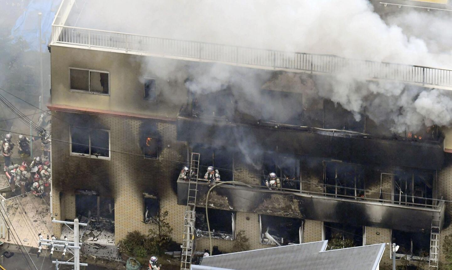 Firefighters respond to a building fire of Kyoto Animation in Kyoto, western Japan.