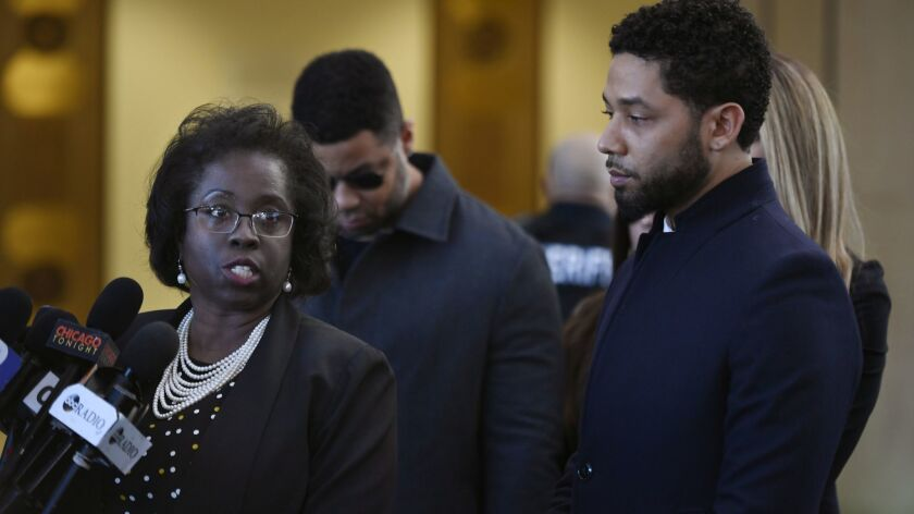 Actor Jussie Smollett, right, stands next to his attorney Patricia Brown Holmes during a news conference at Cook County Court after Smollett's charges were dropped on March 26.