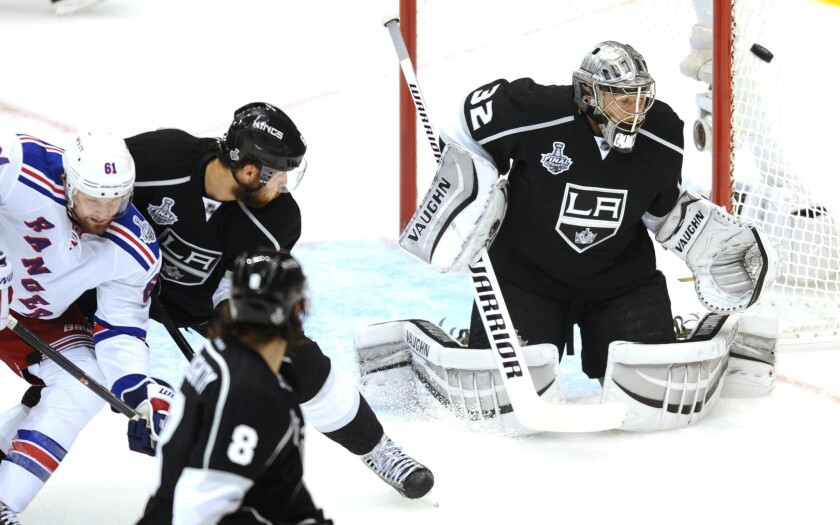 Kings goalie Jonathan Quick makes a save against the New York Rangers during the first period of Game 1 of the Stanley Cup Final.