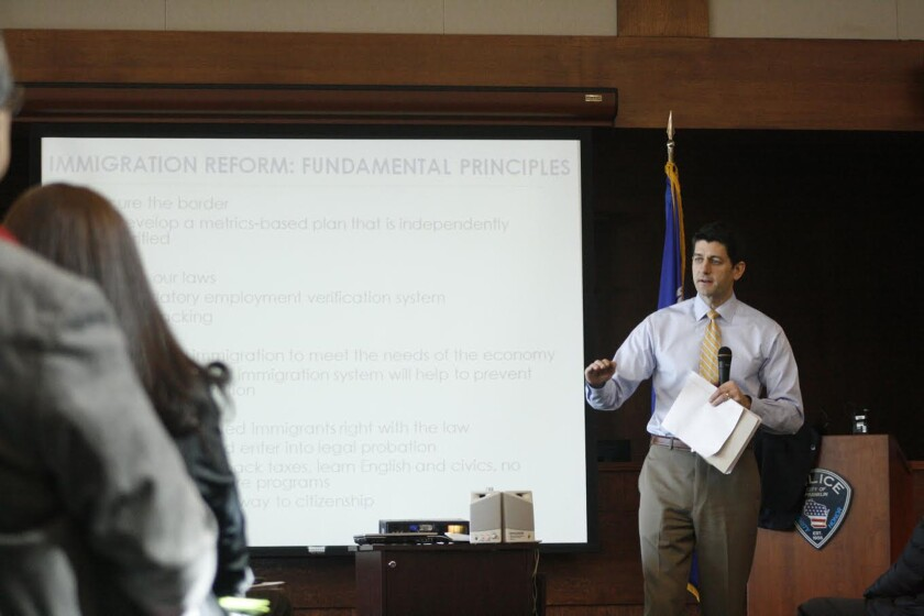 Rep. Paul Ryan (R-Wis.) answers a question at a town hall meeting March 18 in Franklin, Wis.