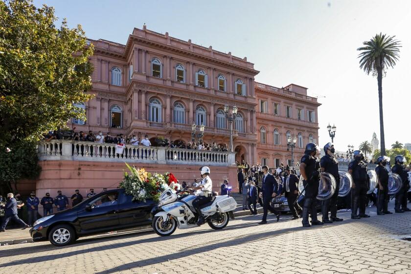 A caravan carrying the casket of Diego Maradona departs the Casa Rosada presidential palace in Buenos Aires.