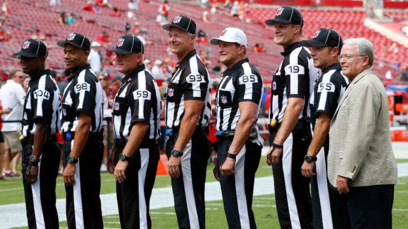 NFL referee Ed Hochuli (85) and his crew line up before a game between the Buccaneers and the Rams on Sept. 25.