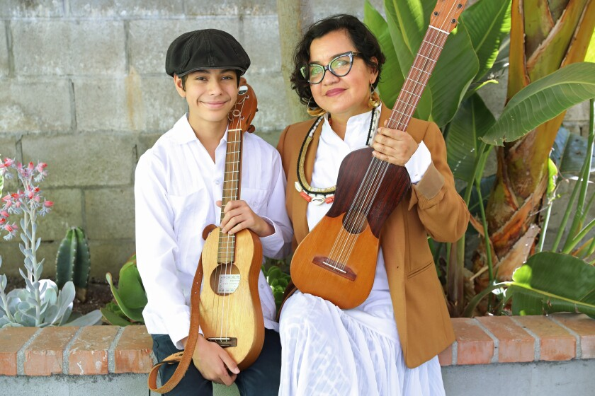 Martha Gonzalezr of music group Quetzal and her son Sandino Gonzalez-Flores, 15, at their home.
