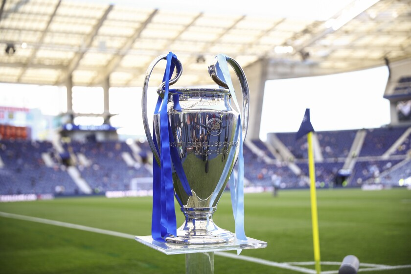 The Champions League trophy is displayed prior to the start of the Champions League final soccer match between Manchester City and Chelsea at the Dragao Stadium in Porto, Portugal, Saturday, May 29, 2021. (Carl Recine/Pool via AP)